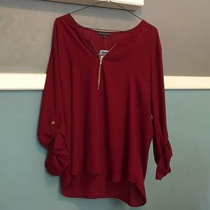 Red blouse with zip detail